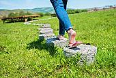 Woman walking on stepping concrete
