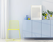 Blue interior with yellow chair