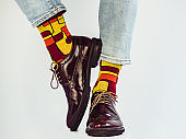 Men's legs, stylish shoes and funny socks.