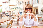 Relaxed woman enjoy her coffee