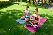 Young couple doing yoga outdoors