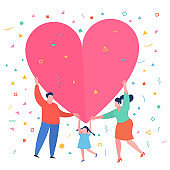Happy family with big red heart. Dad mom and daughter hold a symbol of love