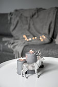 Christmas candles and deer decor in the cozy home interior
