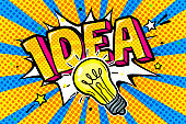 Concept of Idea. Message Idea and Light bulb in pop art style on blue background.