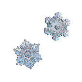 Two snowflakes isolated on white background