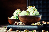 Pistachio ice cream with nuts, decorated with mint leaves