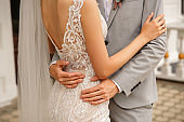 Elegant wedding couple. Bride and groom embracing at wedding day