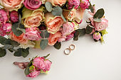 Wedding rings near wedding bouquet