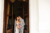 Wedding couple kissing at wedding day. Newlywed couple in love. Elegant bride and groom