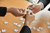 Group of Business people hands are connecting jigsaw puzzle.