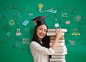 asia women student holding book with with graduation hat on mathematics background in school.