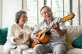 Older Couple enjoying with singing and guitar.