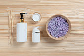 Spa products on wood background.