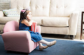 Little princess watching movie at home