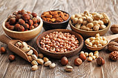 Composition with different kinds of nuts on wooden background
