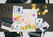 Top view of creative designer brainstorming ducument on wood table in meeting room.