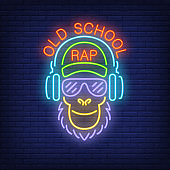 Old school rap neon text and cool monkey in glasses and headphones