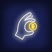 Hand with bitcoin neon sign