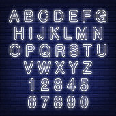 English alphabet and numbers. Neon sign with white letters