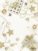 Christmas background from gold  Christmas decorations on white table. Xmas composition of New Year's Christmas balls. Winter holiday concept.Flat lay. Top view. Copy space