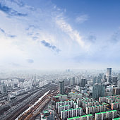 Seoul cityscapes, skyline, high rise office buildings and skyscrapers in Seoul city, winter daylight, top view in winter, Seoul, Republic of Korea, in mist winter season with blue sky and cloud