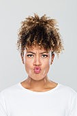 Close up of afro american woman with pout