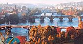Central Prague and six bridges on Vltava river in Prague, Czech Republic, on a misty morning in Fall