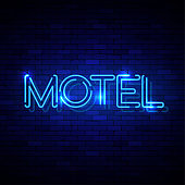 Neon sign on the brick wall