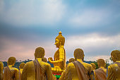golden Big buddha statue and the disciples