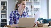 Paperwork, Young Woman Typing On Laptop and working on Documents