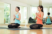 Young asian women practicing yoga, meditation in lotus pose, healthy lifestyle, wellness, well being