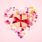 Gift box with beautiful red bow.