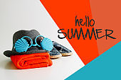 Summer holiday travel concept.Hipster Beach items for a day at the seaside  with hello summer word background