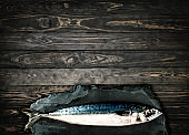 top viewFresh mackerel,fish on stone wood background
