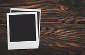 Blank frame photo on wood background with space