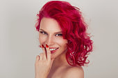Beautiful smiling redhead curly hair woman
