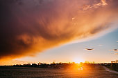 Spring Sunset Sunrise. Sun Above Village In Belarusian Countryside. Bright Dramatic Sky Over Countryside Landscape After Rain. Sun Over Skyline Horizon. Weather Forecast Concept