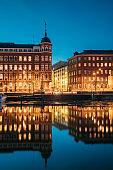 Helsinki, Finland. Crossroad Of Pohjoisranta And Kirkkokatu Street In Evening Or Night Illumination