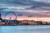 Helsinki, Finland. View Of Embankment With Ferris Wheel In Morning Sunrise Time