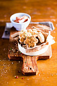 Homemade cookies scones with cheese and bacon in a box on a wooden table, selective focus. Picnic food. Snack food.