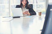 Business woman working and texting on a mobile phone