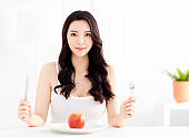 young woman eating apple fruit