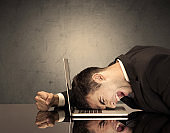 Frustrated businessman's head on keyboard