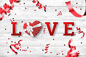 Festive web banner for Valentine's Day. Top view of a composition with a realistic gift in the shape of a heart, inscription love, confetti in the shape of a heart on a white background.