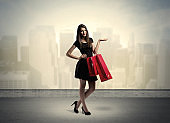 City woman standing with shopping bags