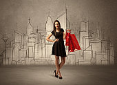 Shopping girl with bags in drawn city