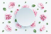 Pattern of pink and beige roses and green leaves on a white background. flat lay, top view, Mixed media. Spring background, Valentine's day, March 8