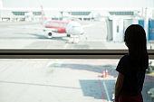 Asian teenage at airport lounge