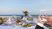 Prepared dining table businessman using smartphone with online payment