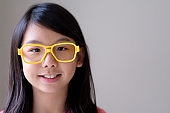 Portrait of Asian teenager with big yellow glasses
